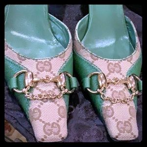 A pair of Green & Beige GUCCI SHOES / Heels